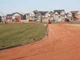 Clay Track Surfacing Installation